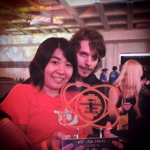 Lucas and Keiko Pope, holding the IGF Trophy at the awards show